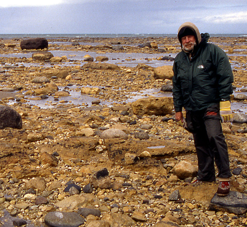 Ed Dobrzanski braves the weather on a boulder shore