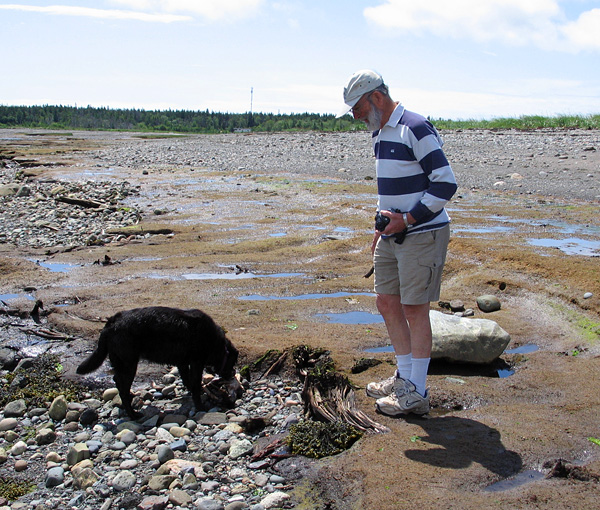 Dick Grant with Noni at the beach beside Castalia Marsh, Grand Manan Island