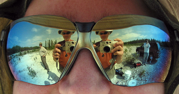 The beginning of a day in the field: Debbie Thompson's safety glasses reflect Sean Robson, me, and Michael Cuggy.