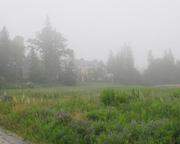 Anderson House, a former mansion converted into residence and dining hall by the Huntsman, is glimpsed through the evening fog