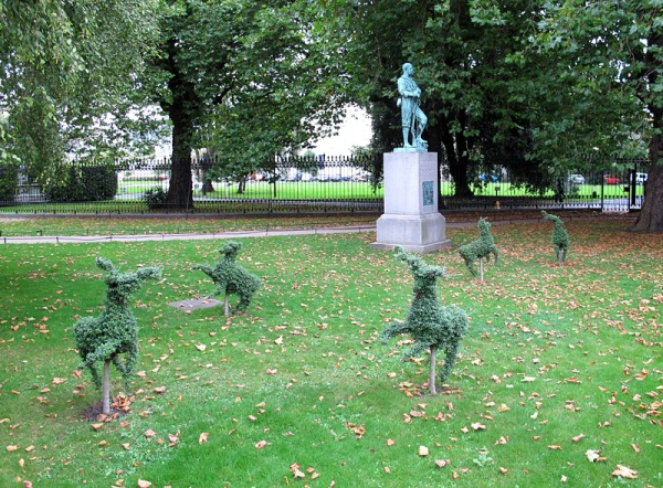 Outside the museum, topiary creatures caper.
