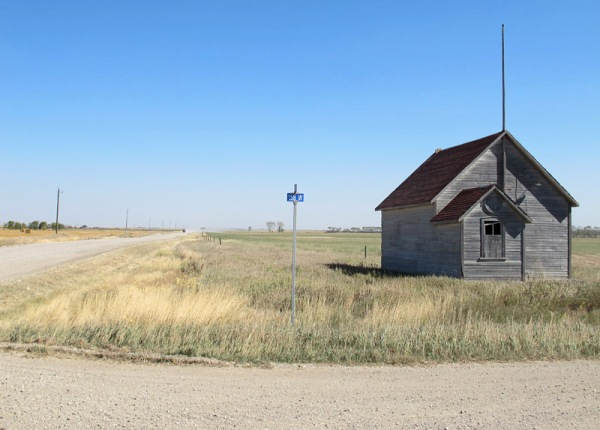 Old schoolhouse at a crossroads in southwestern Manitoba