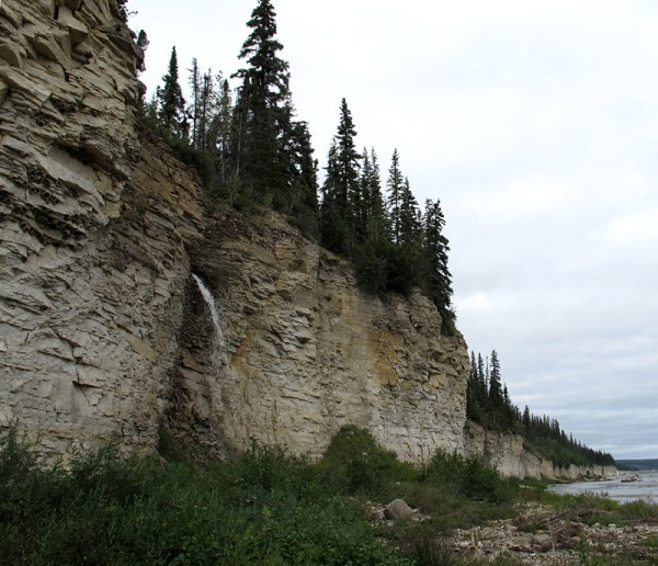 The cliff of Portage Chute Formation. We can't collect from the cliff itself due to treacherous loose overhangs, but there are plenty of lovely fossils in the scree at its foot.