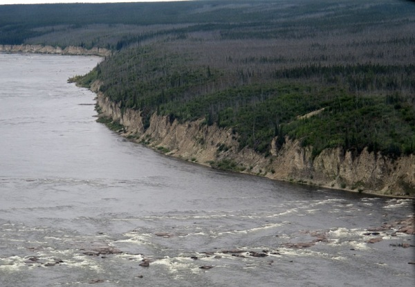 Below Portage Chute, the Churchill River is lined with steep cliffs for many kilometres.