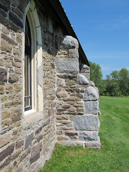 On a buttress of the Jemseg Church, the facing of local sandstone and armouring with Hampstead Granite (above) can be contrasted with the Rainsford Sandstone with Grindstone Island Sandstone armouring  on Christ Church Cathedral in Fredericton (below).