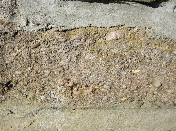 "A very ""dirty sandstone"" containing abundant rock fragments and a mixture of minerals."