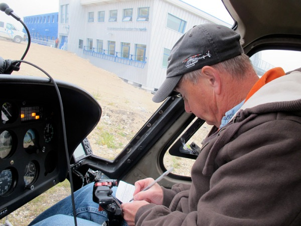 Robert, our pilot, fills in his logbook