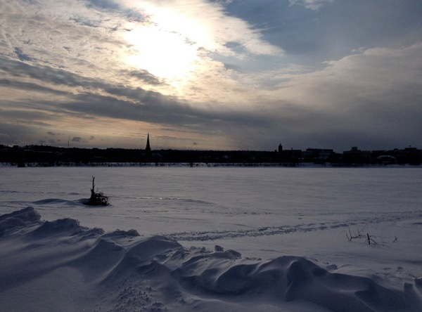 New Brunswick's Saint John River changes dramatically from season to season. In Fredericton in the dead of winter, it is a sahara of snow . . .
