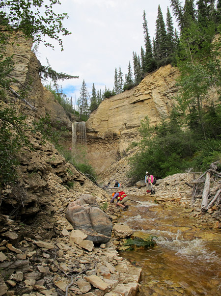 Geologists examine Upper Ordovician strata at Surprise Creek, a tributary of the Churchill River.