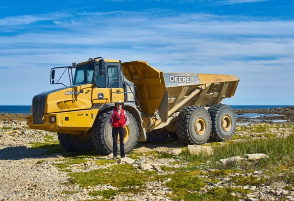 Using specific equipment: me with a quarry truck near Churchill, Manitoba: August, 2016.